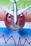 Aeroplano en finanzas y mundo Foto de archivo libre de regalías
