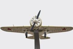 Aeroplano militar aislado en el fondo blanco Foto de archivo