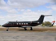 Aeroplano negro del jet Foto de archivo libre de regalías
