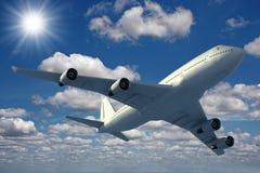 Aeroplano que vuela sobre un cielo azul Fotos de archivo