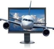 Aeroplano y monitor foto de archivo libre de regalías