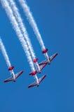 Aeroplanos aeroacrobacias de las personas de AeroShell Foto de archivo libre de regalías