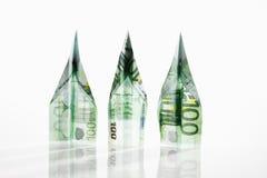 Aeroplanos de papel doblados a partir de 100 billetes de banco euro Imágenes de archivo libres de regalías