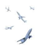 Aeroplanos que vuelan en diversas direcciones Fotos de archivo libres de regalías