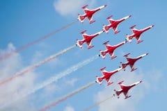 Aeroplanos rojos en el airshow Imágenes de archivo libres de regalías