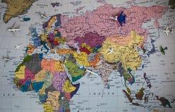Aeroplanos y mapa Fotos de archivo