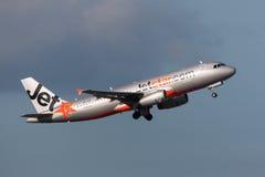 Aeroporto internacional de partida de Jetstar Airways Airbus A320-232 VH-VGF Melbourne Fotografia de Stock