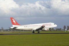 Aeroporto Schiphol de Amsterdão - A320 de Air Arabia Maroc aterra Imagens de Stock Royalty Free