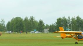 Aeroprakt A-22 light aircrafts on airfield stock footage