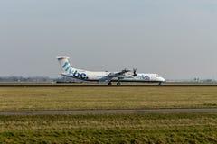 Aeropuerto de Schiphol, Holanda Septentrional/los Países Bajos - 16 de febrero de 2019: Flybe de Havilland Canadá DHC-8-400 G-ECO imagen de archivo libre de regalías