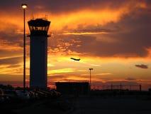 Aeropuerto en la puesta del sol Fotos de archivo libres de regalías
