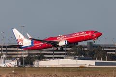 Aeropuerto internacional de salida de Boeing 737-8FE VH-VOT Melbourne de las líneas aéreas de Virgin Blue Fotografía de archivo libre de regalías