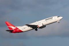 Aeropuerto internacional de salida de Qantas Boeing 737-476 VH-TJK Melbourne Foto de archivo