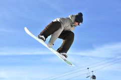 Aeroski: girl snowboarder on a high jump Royalty Free Stock Image