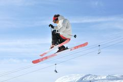 Aeroski: a skier on a high jump. Aeroski: a skier clothed in black and white practicising aerial skiing Stock Images