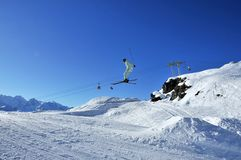 Aeroski: skier in pale green on jump Royalty Free Stock Photography