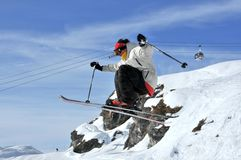 Aeroski: a skier performs a high jump. Aeroski: a skier with white jacket practices aerial skiing Stock Photo
