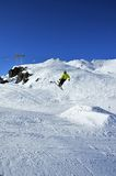 Aeroski: skier in yellow jacket takes off Stock Images