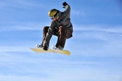 Aeroski: snowboarder touches his board Stock Photos