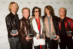 Aerosmith at 2001 American Music Awards. Aerosmith takes pictures with their awards from the 2001 American Music Awards Royalty Free Stock Image