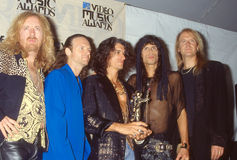 Aerosmith at the MTV Music Awards. Members of the Rock band Aerosmith together at the MTV Music awards. (Image taken from color slide Royalty Free Stock Photography