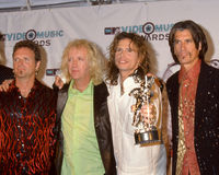 Aerosmith at the MTV Music Awards. Members of the Rock band Aerosmith together at the MTV Music awards in 1998. (Image taken from color slide Royalty Free Stock Photos