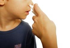 Aerosol nasal del niño Fotografía de archivo libre de regalías