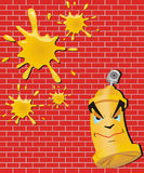 Aerosol of a paint and blot on a background of a b. Aerosol with a yellow paint and four yellow spots on a background of a red brick wall Royalty Free Stock Photography