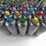 Aerosol Spray cans. Aluminum spray cans with differently colored nozzles royalty free stock image