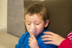 Aerosol therapy. Child making aerosol therapy with nebuliser royalty free stock image