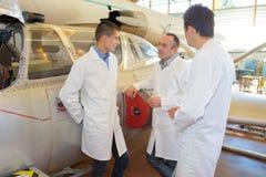 Aerospace engineers having conversation Royalty Free Stock Photography