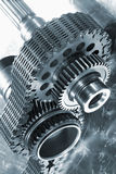 Aerospace gears and timing chain. Large titanium aerospace gears with timing chain, duplex blue toning concept royalty free stock photos
