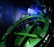 Aerospace Welder. Welder working on an automatic welding machine Stock Photo