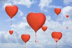 Aerostati del cuore su cielo blu Fotografia Stock