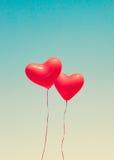 Aerostati a forma di del cuore rosso fotografia stock