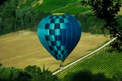 Heavenly hot air balloon flying high in the sky stock photo
