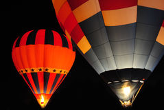 Aerostato di aria calda alla notte. Fotografia Stock