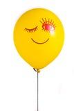 Aerostato giallo con il sorriso Immagine Stock