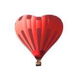 Aerostato rosso sotto forma di un cuore isolato su un fondo bianco Fotografia Stock