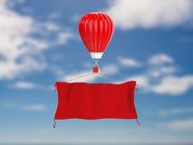 Aerostato rovente con l'insegna rossa del panno Immagini Stock