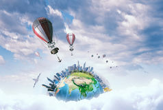 Aerostats flying over sky . Mixed media Royalty Free Stock Images