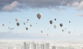Aerostats in sky Stock Photo