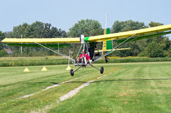Aerotow Plane Landing on Airstrip Stock Images