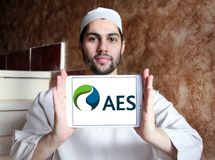 AES energy corporation logo. Logo of AES energy corporation on samsung tablet holded by arab muslim man. The AES Corporation is a Fortune 200 company that Royalty Free Stock Photo