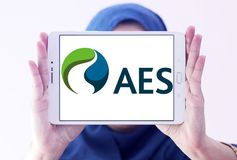 AES energy corporation logo. Logo of AES energy corporation on samsung tablet holded by arab muslim woman. The AES Corporation is a Fortune 200 company that Royalty Free Stock Image