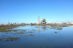 AES Power Plant and Magnolia Wetlands. HUNTINGTON BEACH, CA - NOVEMBER 6, 2014: The AES Power Plant on Pacific Coast Highway seen from the Magnolia Wetlands. The Royalty Free Stock Image