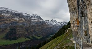 Aescher Wildkirchli Appenzell. Panorama Picture of the Aescher in the Appenzeller mountains. This location is very well known after it was in National Geographic royalty free stock images