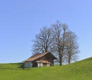 从Aeschiried的老农厂房子 库存照片