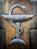 Aesculapian staff - Caduceus. At a historic gravestone stock photography