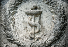 Aesculapian staff - Caduceus Stock Photo